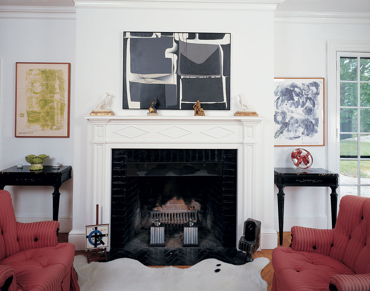 Left and loop right above the mantel hangs a painting by abstract
